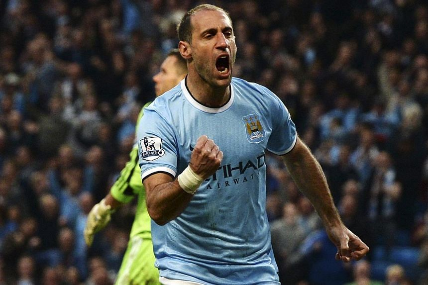 Manchester City's Pablo Zabaleta celebrates after scoring a goal against West Bromwich Albion during their English Premier League soccer match at the Etihad stadium in Manchester, northern England on April 21, 2014. -- PHOTO: REUTERS