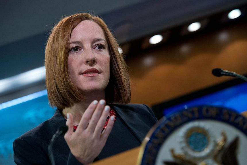 """US State Department spokeswoman Jen Psaki speaks at the daily briefing at the State Department in Washington, DC on March 10, 2014.""""If they don't take steps in the coming days, there'll be consequences,"""" she said at a Monday news briefing. -- F"""