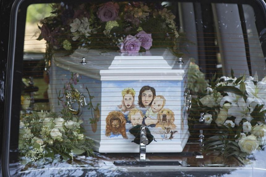 A hearse carrying the coffin of Peaches Geldof, painted with a picture of her family, arrives for her funeral service at the St Mary Magdalene and St Lawrence church in Davington, southeast England on April 21, 2014. -- PHOTO: REUTERS