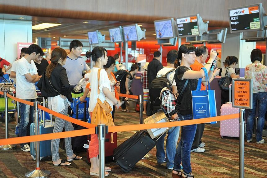 """The study by the Competition Commission of Singapore found that tie-ups can generate """"substantial benefits"""" for consumers, such as lower air fares, better service and greater connectivity choice. -- ST FILE PHOTO"""