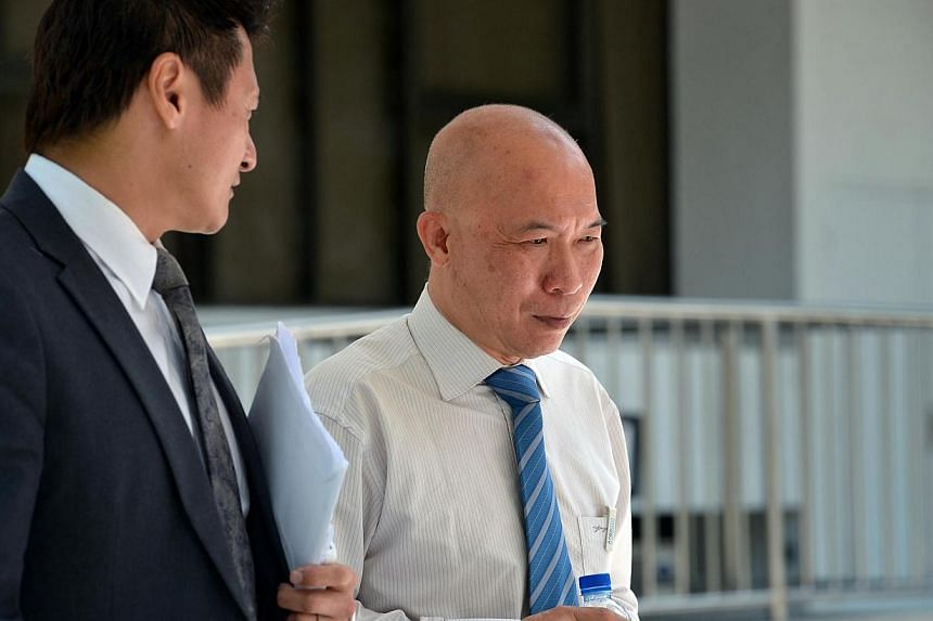 Dr Edward Foo (right) leaving the State Courts on April 14, 2014. The second liposuction death was a misadventure, said the State Coroner.-- ST FILE PHOTO:KUA CHEE SIONG