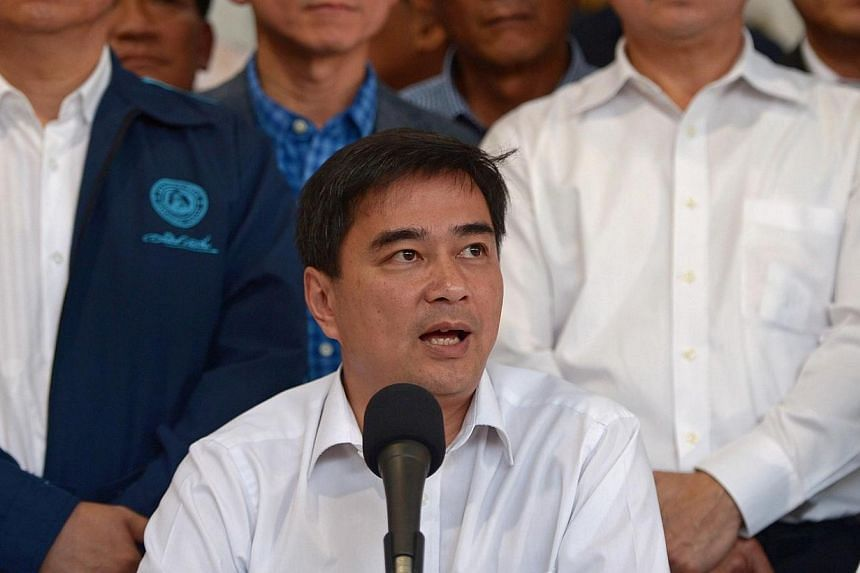 Democrat Party leader Abhisit Vejjajiva (centre) speaking next to his party members during a press conference held to announce the party's boycott of snap elections at the Democrat Party headquarters in Bangkok on Dec 21, 2013.Negotiations on a