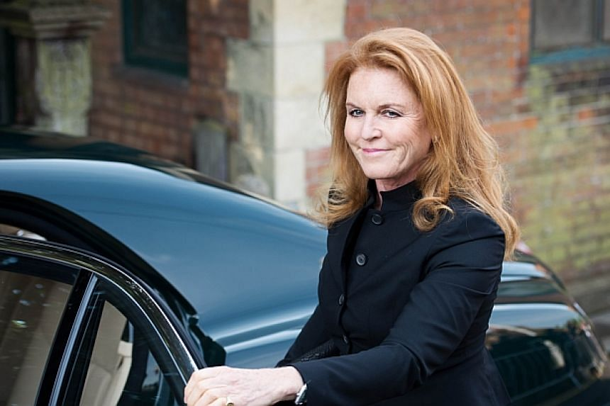 Sarah Ferguson, the Duchess of York, arrives at St Mary Madgalene and St Lawrence Church in Davington, Kent ahead of the funeral of Peaches Geldof on April 21, 2014. -- PHOTO: AFP