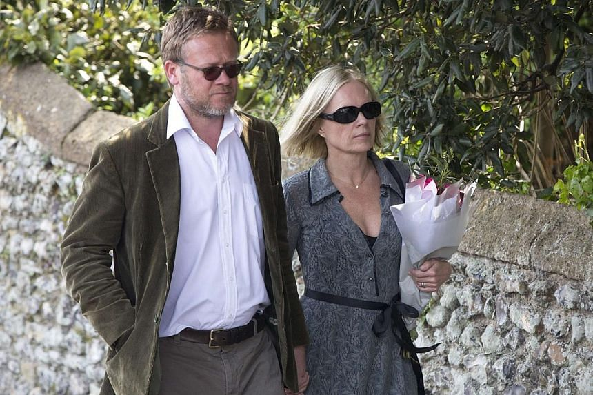 Journalist Mariella Frostrup (right) and Jason McCue arrive at the funeral service for Peaches Geldof at the St Mary Magdalene and St Lawrence church in Davington, southeast England on April 21, 2014. -- PHOTO: REUTERS