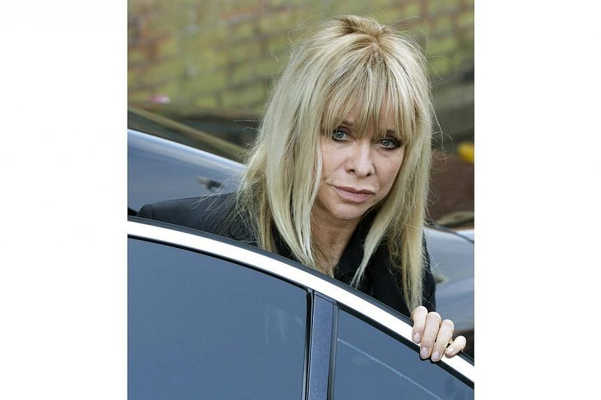 Jo Wood, the former wife of Rolling Stone Ronnie Wood, arrives at the funeral service for Peaches Geldof at the St Mary Magdalene and St Lawrence church in Davington, southeast England on April 21, 2014. -- PHOTO: REUTERS