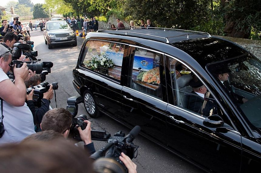 The decorated coffin of Peaches Geldof arrives in a hearse at St Mary Madgalene and St Lawrence Church in Davington, Kent on April 21, 2014. -- PHOTO: AFP