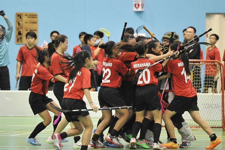 Bukit Merah Secondary School's B Division Girls celebrating their win at the finals for B Division floorball championships at Bedok Sports Hall on Apr 23 2014. Bukit Merah Secondary School (BMSS) emerged as the outstanding school in  the Sc