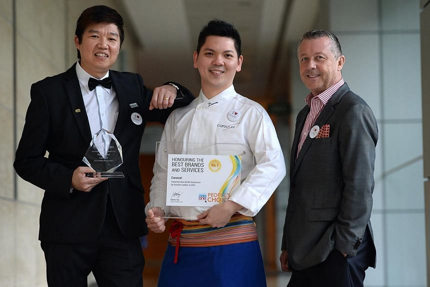 From left: Mr Abraham Tan, F&B Manager for Carousel, Mr Darren Ong, executive Sous Chef for Carousel and Mr Patrick Garcia Fiat, General Manager of Royal Plaza on Scotts. -- ST PHOTO: JOYCE FANG