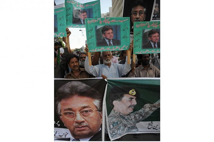Supporters of Pakistan's former military ruler Pervez Musharraf carry his portraits during a protest in Karachi on April 13, 2014.Pakistani former military ruler Pervez Musharraf, facing a battery of criminal cases, must wait a fortnight to lea