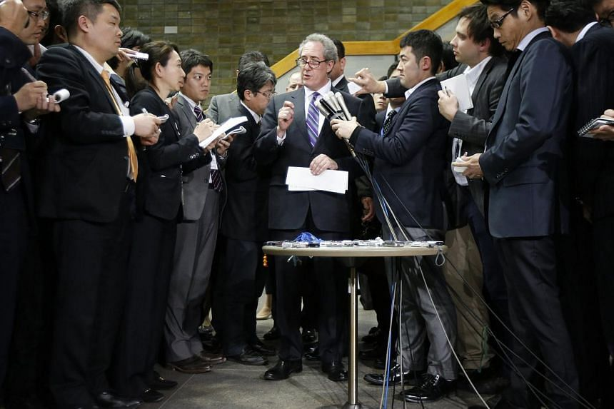 US Trade Representative Michael Froman (centre) speaks to media members after meetings with Japan's Economics Minister Akira Amari (not in picture) in Tokyo April 10, 2014. Froman arrived in Japan earlier than expected on Wednesday, Japanese media sa
