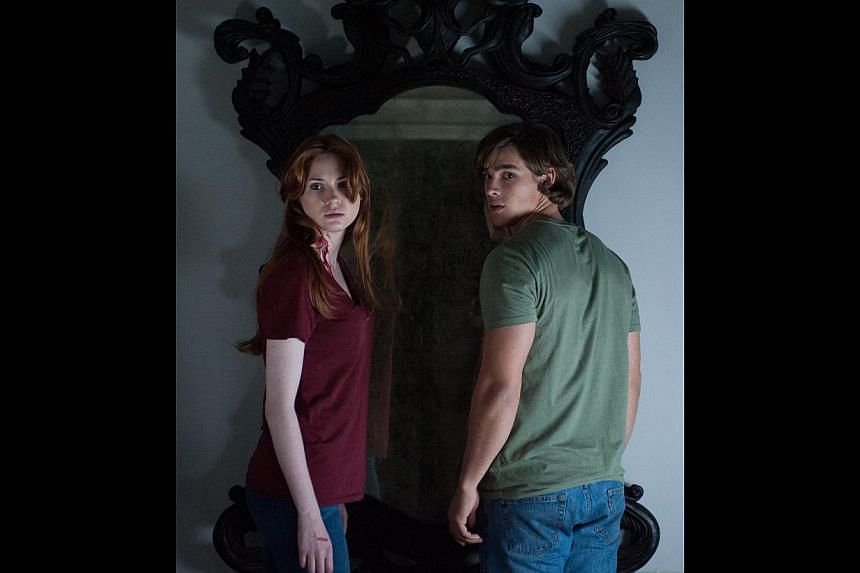 In Oculus, Karen Gillan ropes in her on-screen brother (Brenton Thwaites, both left) to take down a mirror that supposedly houses a demonic spirit.