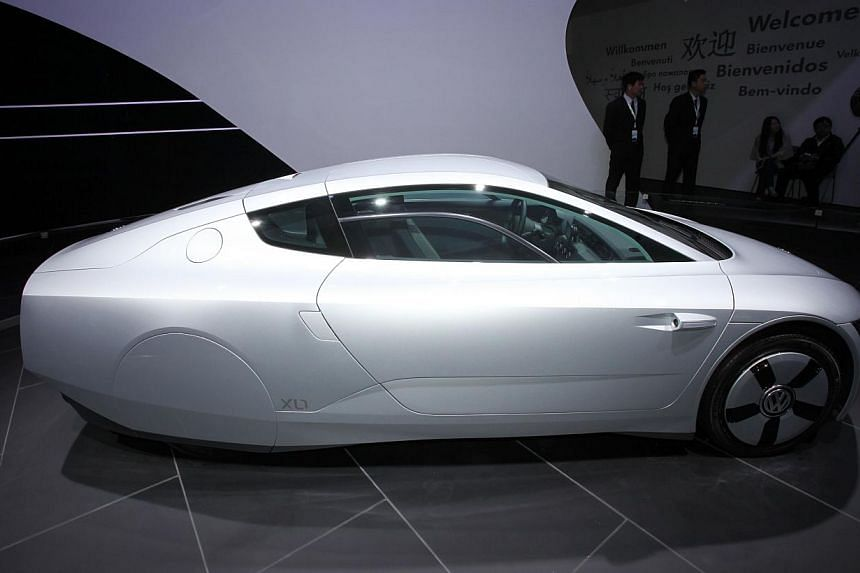 A Volkswagen XL1 car on display at the China International Exhibition Centre during the Auto China 2014 Beijing International Automotive Exhibition in Beijing, on April 20, 2014. -- FILE PHOTO: AFP
