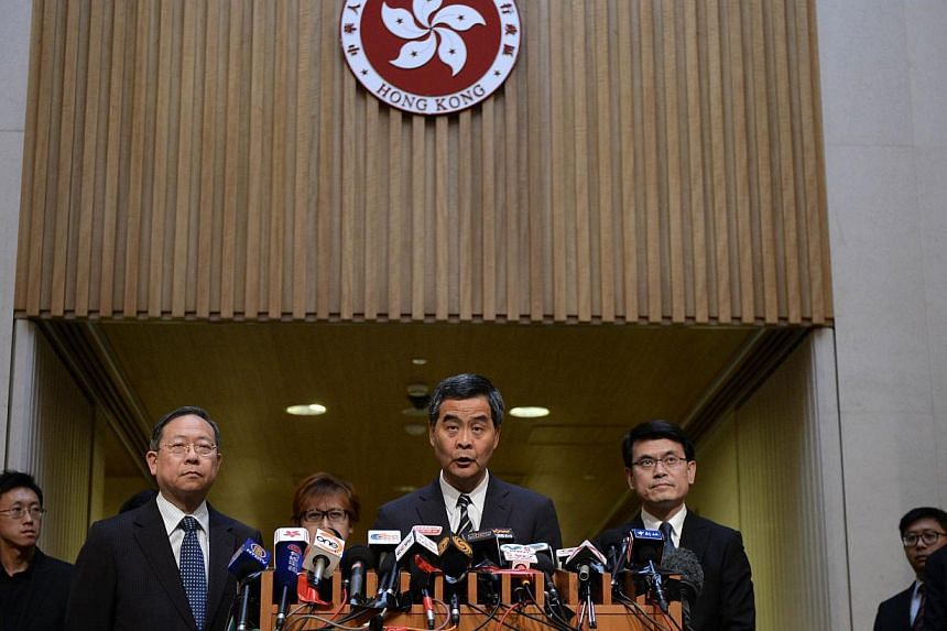 Hong Kong Chief Executive Leung Chun-ying speaks during a press conference in Hong Kong, on April 23, 2014. The Hong Kong government said on Wednesday that a long-running dispute with the Philippines over a deadly hostage crisis had ended follow