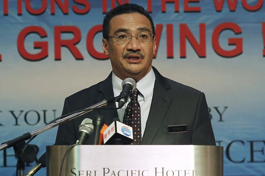 Malaysia's Defence Minister and acting Transport Minister Hishammuddin Hussein speaks at a news conference inside the hotel near the Putra World Trade Centre (PWTC) in Kuala Lumpur, on April 17, 2014. Malaysia's Cabinet has approved the appointm