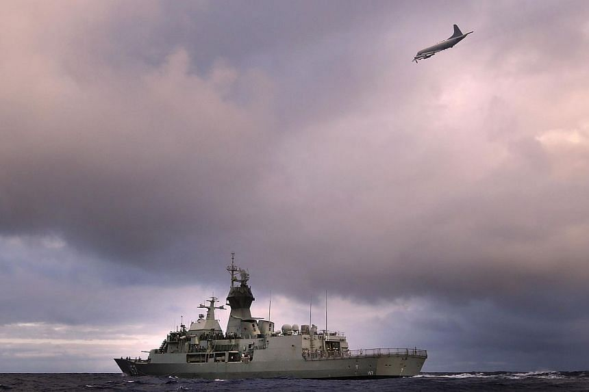 HMAS Perth transiting through the Southern Indian Ocean as an Orion P-3K of the Royal New Zealand Air Force searches for debris for missing Malaysia Airlines flight MH 370 in the southern Indian Ocean, on April 13, 2014. Australian Transport Safety B