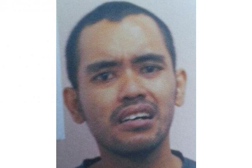 The Malaysian who was arrested on Monday for attempting to enter Singapore without proper immigration clearance was charged in court on Wednesday, April 23, 2014, and remanded for psychiatric assessment. -- PHOTO: IMMIGRATION AND CHECKPOINTS AUTHORIT