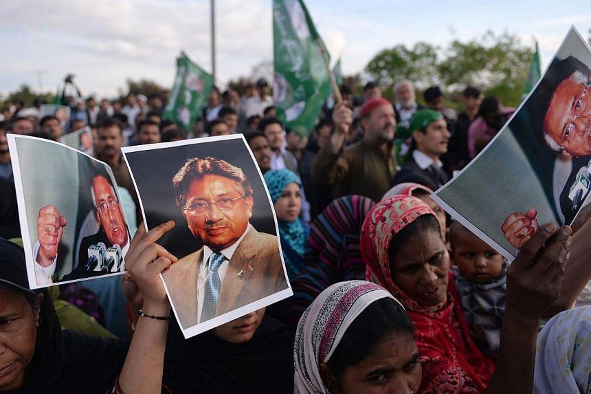 Supporters of Pakistan's former military ruler Pervez Musharraf, hold his posters as they shout slogans during a rally outside his farmhouse in Islamabad, on April 18, 2014. Pakistani former military ruler Pervez Musharraf, facing a battery of crimin