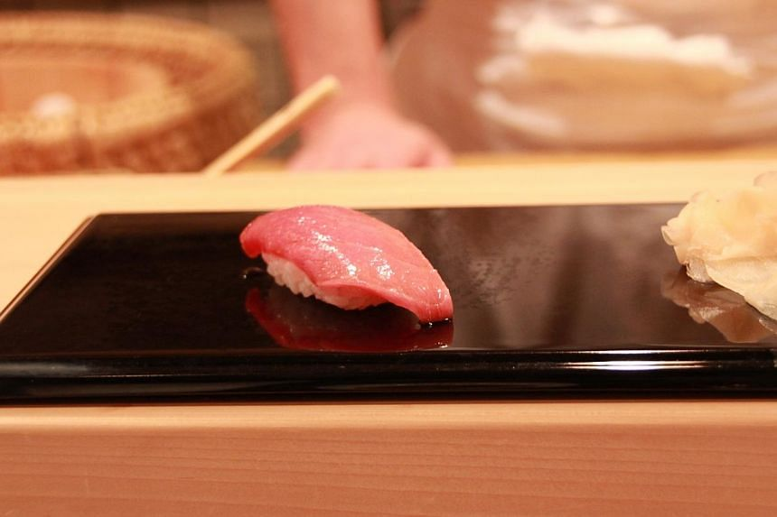 The chu-toro (semi-fatty tuna) sushi that was being served at Sukiyabashi Jiro restaurant, located in the basement of an office building in Tokyo's Ginza district and home to the Michelin-starred sushi chef Jiro Ono. -- ASIAONE FILE PHOTO: SATOKO N