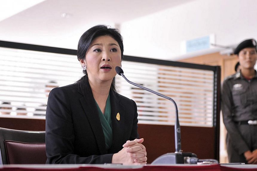 Thailand's Constitutional Court on Wednesday, April 23, 2014, gave Prime Minister Yingluck Shinawatra more time to submit her defence against allegations of abuse of power which could see her removed from office. -- FILE PHOTO: REUTERS