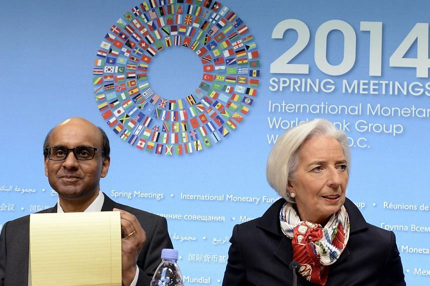 IMF Managing Director Christine Lagarde (right) and Singapore's Finance Minister Tharman Shanmugaratnam, who is also the International Monetary and Financial Committee (IMFC) chairman, arrive to begin a press briefing during the IMF and World Bank 20