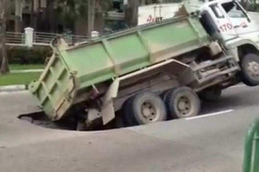 A section of Upper Changi Road East near Jalan Demak has caved in.-- SCREENGRAB: YOUTUBE