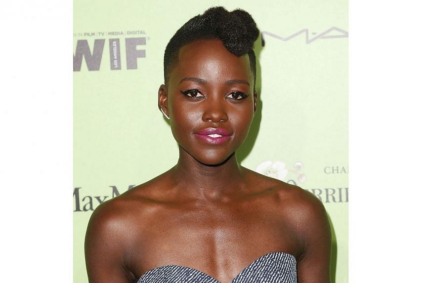 Actress Lupita Nyong'o attends the Women in Film Pre-Oscar Cocktail Party Presented by Perrier-Jouet, MAC & MaxMara at the Fig & Olive Melrose Place on Feb 28, 2014 in West Hollywood, California. -- FILE PHOTO: AFP
