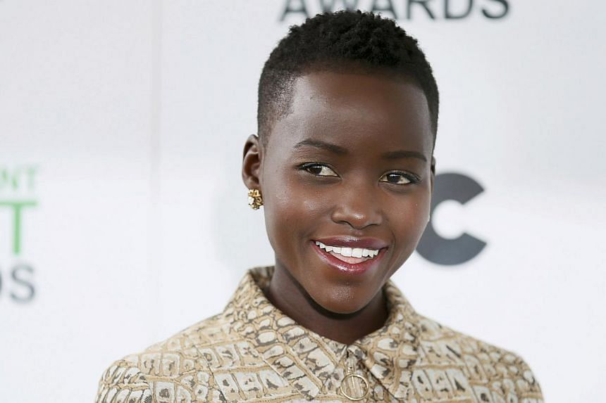 Nominee for Best Supporting Female award Lupita Nyong'o from 12 Years a Slave arrives at the 2014 Film Independent Spirit Awards in Santa Monica, California on March 1, 2014. -- FILE PHOTO: REUTERS