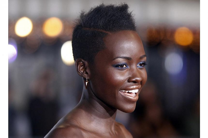 Cast member Lupita Nyong'o poses at the premiere of the film Non-Stop in Los Angeles on Feb 24, 2014. -- FILE PHOTO: REUTERS