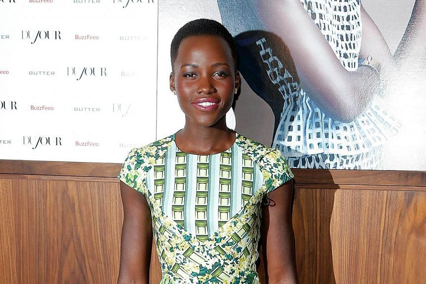 Actress Lupita Nyong'o attends the Dujour Magazine Winter 2013-2014 Cover Star Lupita Nyong'o celebration hosted by Jason Binn at Butter Restaurant on Feb 19, 2014 in New York City. -- FILE PHOTO: AFP