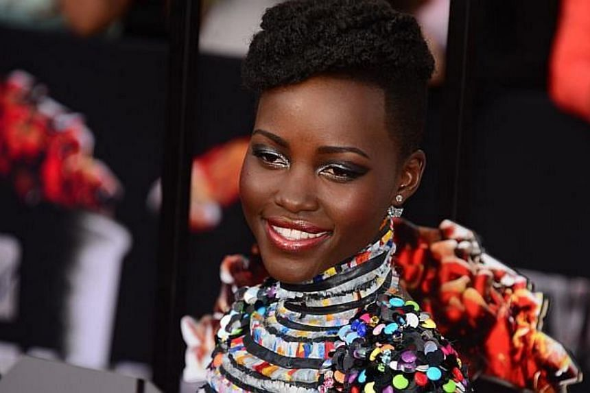 Actress Actress Lupita Nyong'o arrives on the red carpet for the 2014 MTV Movie Awards at the Nokia Theater in Los Angeles, California, on April 13, 2014. -- FILE PHOTO: AFP