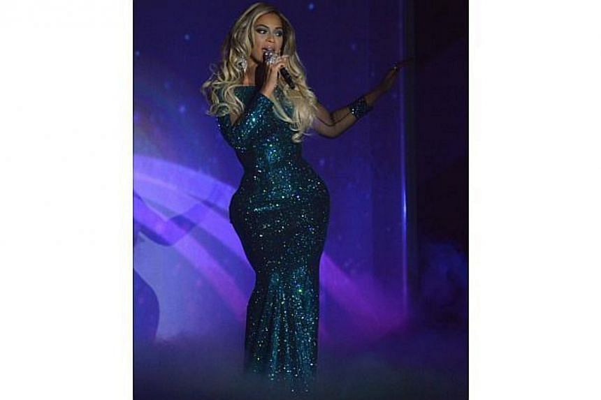 Singer Beyonce performs at the BRIT Awards, celebrating British pop music, at the O2 Arena in London on Feb 19, 2014. -- FILE PHOTO: REUTERS