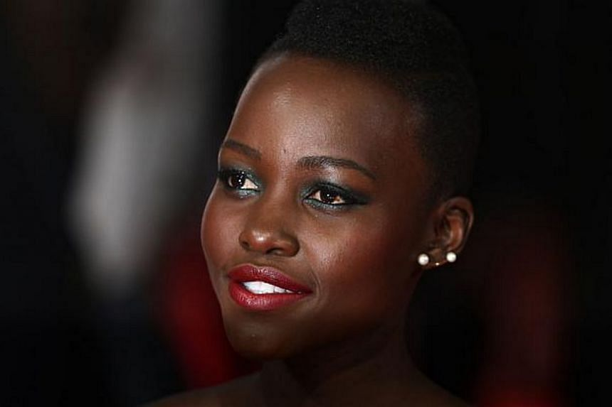 Kenyan-Mexican actress and director Lupita Nyong'o arrives on the red carpet for the BAFTA British Academy Film Awards at the Royal Opera House in London on Feb 16, 2014. -- FILE PHOTO: AFP