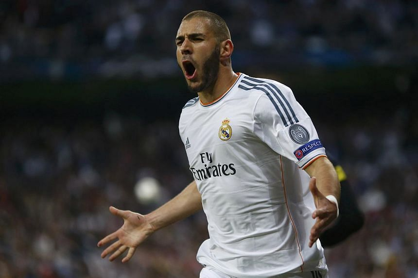 Real Madrid's Karim Benzema celebrates after scoring a goal against Bayern Munich during their Champion's League semi-final first leg match at the Santiago Bernabeu stadium in Madrid on April 23, 2014. -- PHOTO: REUTERS