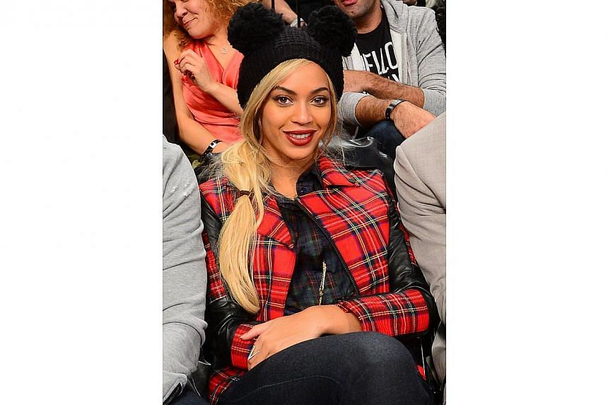 Beyonce at an NBA game between the Philadelphia 76ers and the Brooklyn Nets at the Barclays Center in New York on Feb 3, 2014. -- FILE PHOTO: AFP