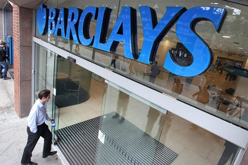"""A customer enters a branch of Barclays bank, part of Barclays Plc, in London, UK on Friday, July 30, 2010.Barclays said its first-quarter profit fell after a """"significant"""" drop in revenue from its investment bank's fixed- income operations, ext"""