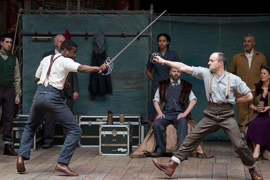 Members of the cast of a new touring production of William Shakespeare's Hamlet perform during a photocall at the Globe theatre in London on April 23, 2014.William Shakespeare's plays are to be performed in mid-air as Britain celebrates the 450