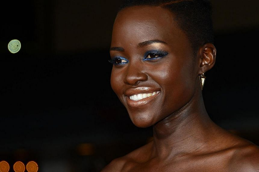 """Lupita N'yongo poses on arrival for the world premiere of the film """"Non-Stop"""" on February 24, 2014 in Los Angeles, California. The film opens nationwide in the US on Feb 28. -- FILE PHOTO: AFP"""