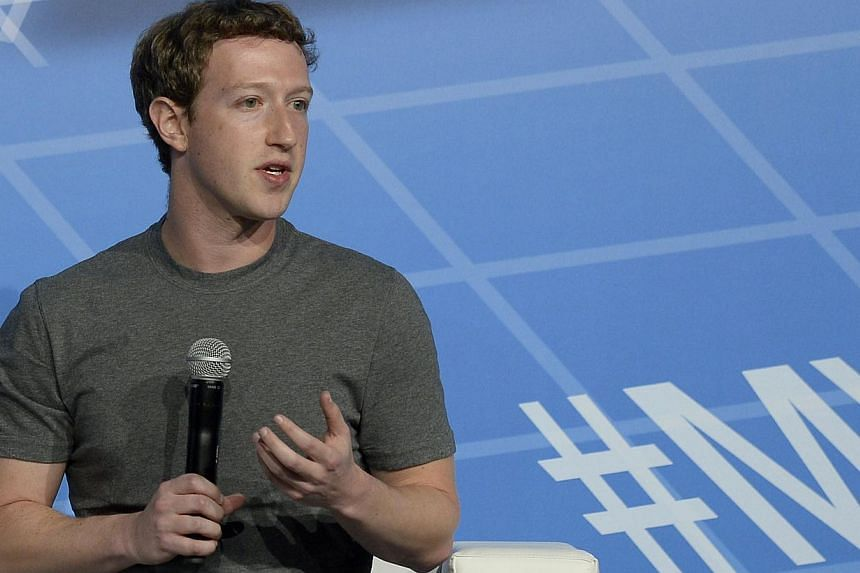 Facebook's billionaire creator Mark Zuckerberg speaks on the opening day of the Mobile World Congress in Barcelona on Feb 24, 2014. -- FILE PHOTO: AFP