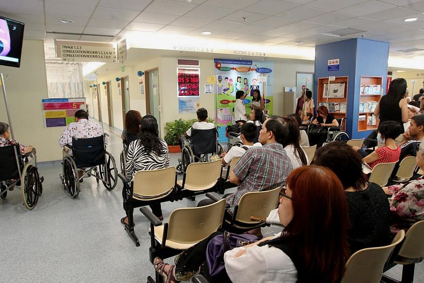 Patients waiting outside the consultation rooms at the Accident & Emergency (A&E) Department at Changi General Hospital (CGH). -- FILE PHOTO: BH