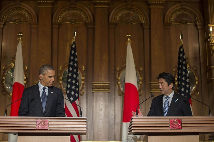 US President Barack Obama (left) and Japan Prime Minister Shinzo Abe at a press conference at the Akasaka Palace in Tokyo on April 24, 2014.