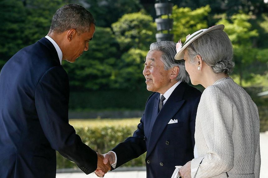 US President Barack Obama (left) is welcomed by Japan's Emperor Akihito and Empress Michiko (right) upon his arrival at the Imperial Palace in Tokyo on April 24, 2014. -- PHOTO: REUTERS