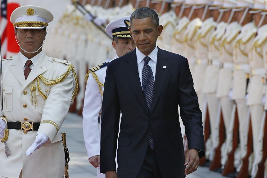 US President Barack Obama (right) reviews an honour guard during a welcome ceremony at the Imperial Palace in Tokyo on April 24, 2014. Obama inspected the guard at a pomp-filled ceremony with Emperor Akihito on April 24, kicking off the formal procee