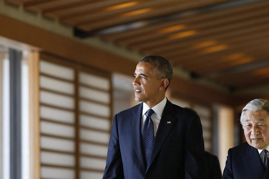 US President Barack Obama looks at outside as he walks with Japan's Emperor Akihito (right) in the Imperial Palace in Tokyo on April 24, 2014. -- PHOTO: REUTERS