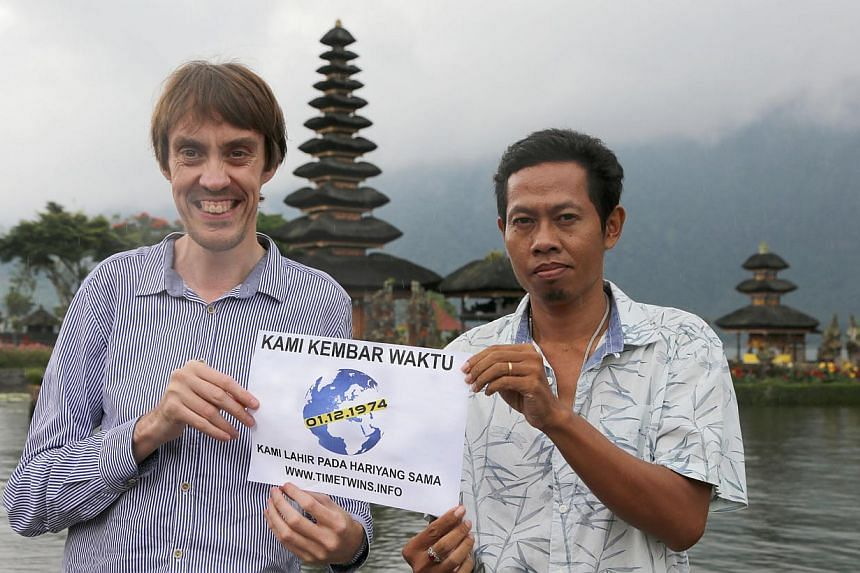 Mr Avis with Indonesian tour guide Pasek Bratayasa at a temple in Bali. The Englishman is on a global quest to find people born on the same day as him - Dec 1, 1974.
