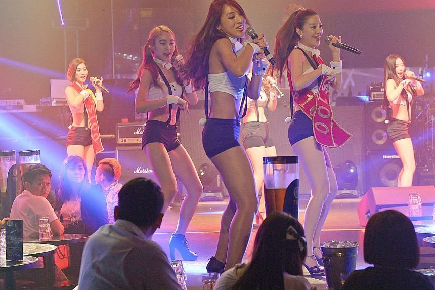 South Korean group Viva Girls (above) show off their polished dance moves while singing at Neverland II. -- PHOTO: DESMOND WEE