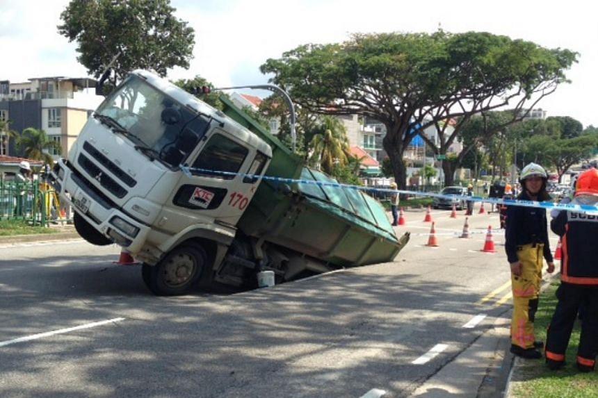 Tipper truck in sink hole near Jalan Demak on April 24, 2014. -- ST PHOTO: JOYCE FANG