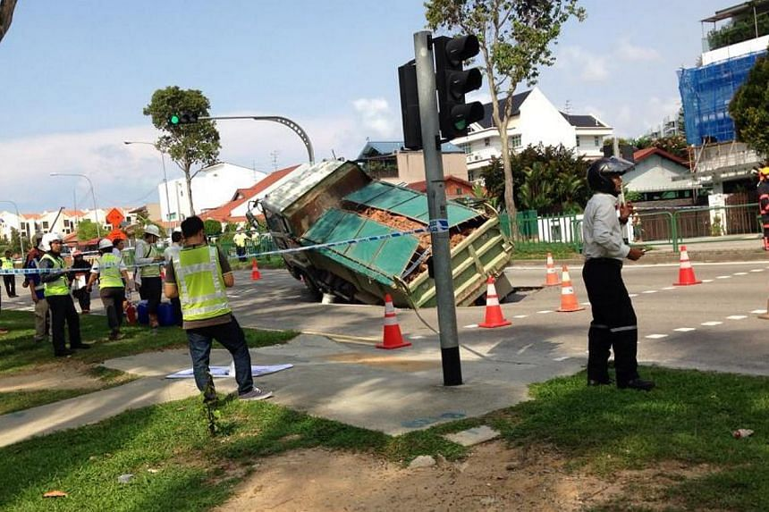 A section of Upper Changi Road East near Jalan Demak has caved in. -- PHOTO: COURTESY OF ALTHEA LEW