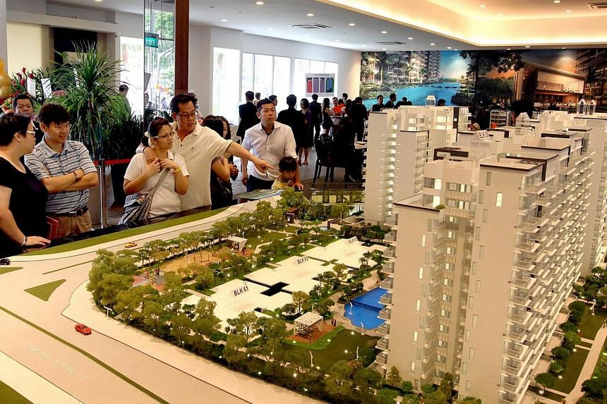 Prospective buyers viewing a model of CityLife@Tampines, a 514-unit executive condominium (EC), at the showflat.More than 11,000 Singaporean families bought Executive Condominiums (ECs) from the fourth quarter of 2010 to the same period in 2013