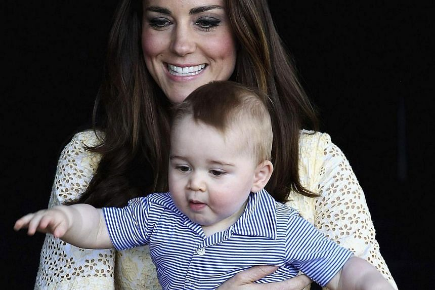 Catherine, the Duchess of Cambridge, carries her son Prince George while visiting at an Australian animal called a Bilby, which has been named after the young prince, during a visit to Sydney's Taronga Zoo on April 20, 2014.The so-called Kate E