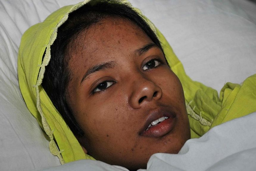 Bangladeshi garment worker Reshma Akhter, who survived 17 days under the rubble after the eight-storey Rana Plaza building collapsed, rests in Savar Cantonment Hospital on the outskirts of Dhaka on May 11, 2013. -- FILE PHOTO: AFP